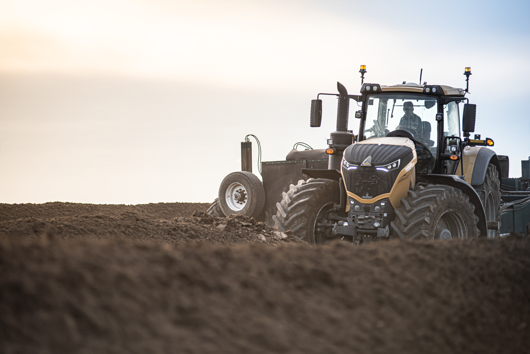 Tractor in field turning compost rows. Isaac Miller Photography  | Agriculture & Industry Photographer  |  Commercial & Editorial photography  |   Missoula + San Antonio
