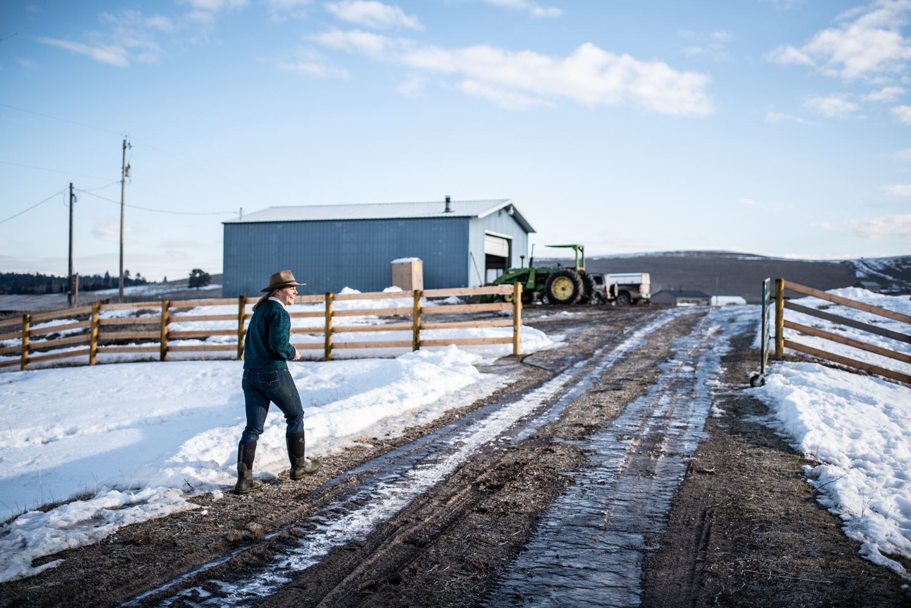 Rancher walking back to barn after feeding cattle. Isaac Miller Photography  | Agriculture & Industry Photographer  |  Commercial & Editorial photography  |   Missoula + San Antonio