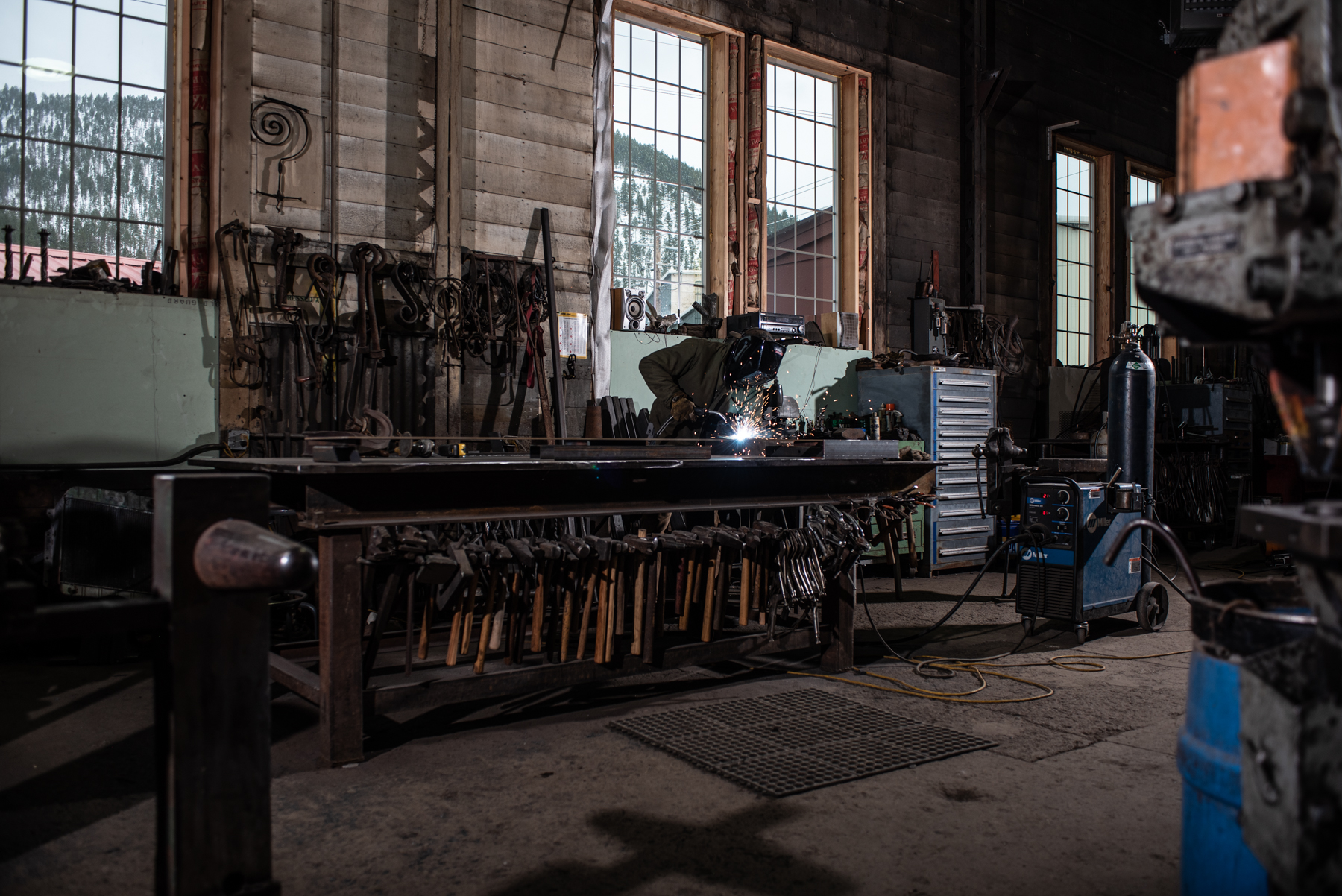 Welder in old industrial building. Isaac Miller Photography  | Agriculture & Industry Photographer  |  Commercial & Editorial photography  |   Missoula + San Antonio