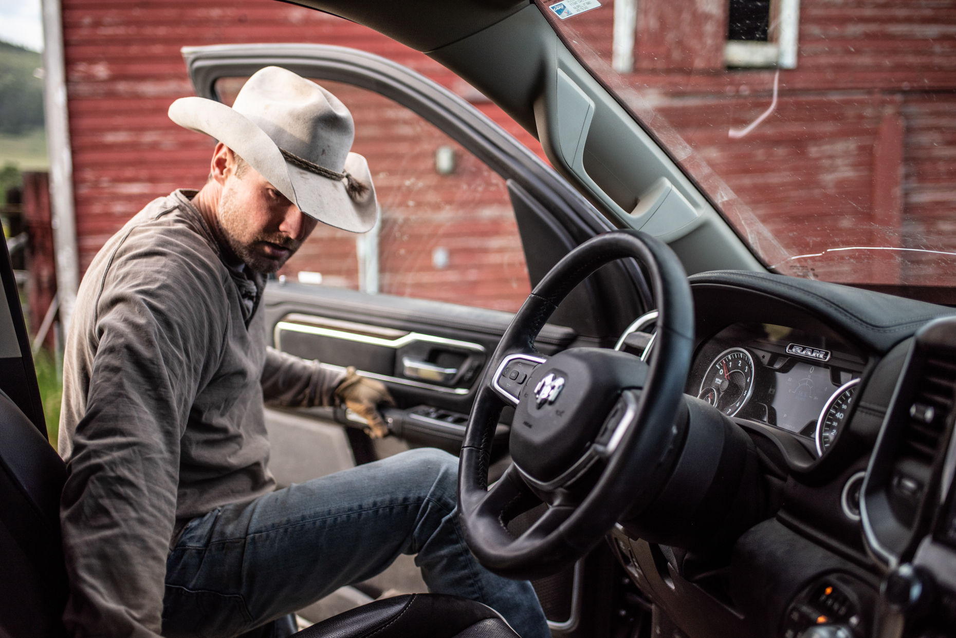 Rancher getting in Ram truck. Isaac Miller Photography  | Agriculture & Industry Photographer  |  Commercial & Editorial photography  |   Missoula + San Antonio