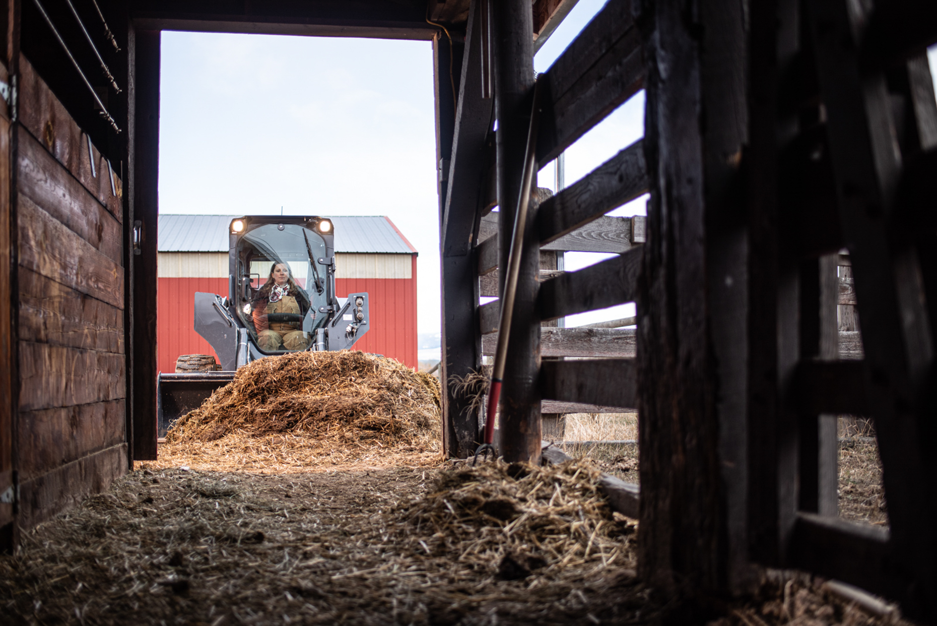 John Deere loader cleaning cattle pens. Isaac Miller Photography  | Agriculture & Industry Photographer  |  Commercial & Editorial photography  |   Missoula + San Antonio